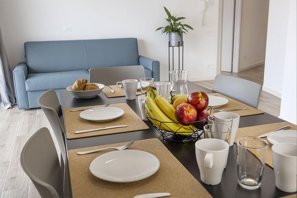 Ampio Trilocale residence Solei Plus per vacanze con famiglia, divanoletto in soggiorno
